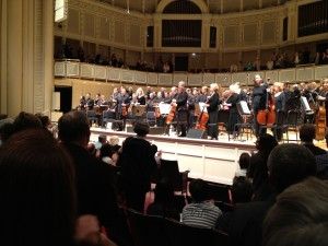 MTT and the orchestra musicians acknowledge applause from the standing crowd