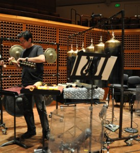 Percussionist Ray Froehlich assembles his array of instruments for Lou Harrison's Concerto for Organ with Percussion Orchestra